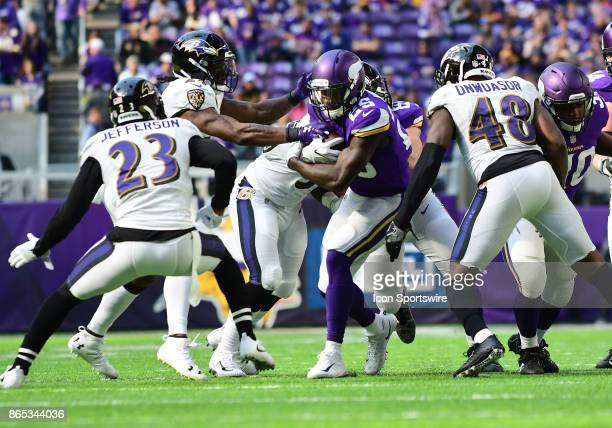 Minnesota Vikings running back Latavius Murray is surrounded by Ravens defenders during a NFL game between the Minnesota Vikings and Baltimore Ravens...