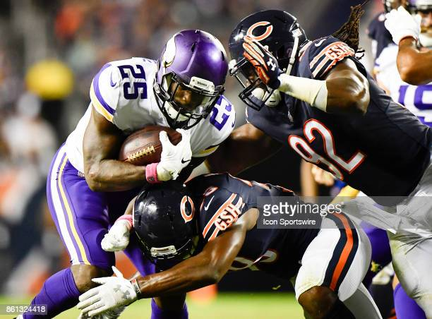 Minnesota Vikings running back Latavius Murray is tackled by Chicago Bears strong safety Adrian Amos and Chicago Bears outside linebacker Pernell...