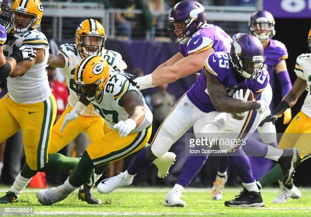 Minnesota Vikings running back Latavius Murray spins away from Green Bay Packers defensive tackle Kenny Clark during a NFL game between the Minnesota...