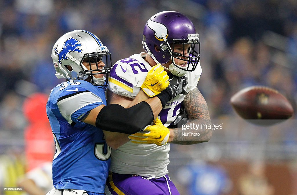 Minnesota Vikings tight end Kyle Rudolph (82) is wrapped up by Detroit Lions strong safety Miles Killebrew (35) during the first half of an NFL football game in Detroit, Michigan USA, on Thursday, November 24, 2016.