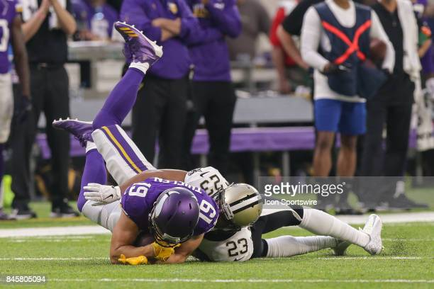 Minnesota Vikings wide receiver Adam Thielen is tackled by New Orleans Saints cornerback Marshon Lattimore during the game between between the...