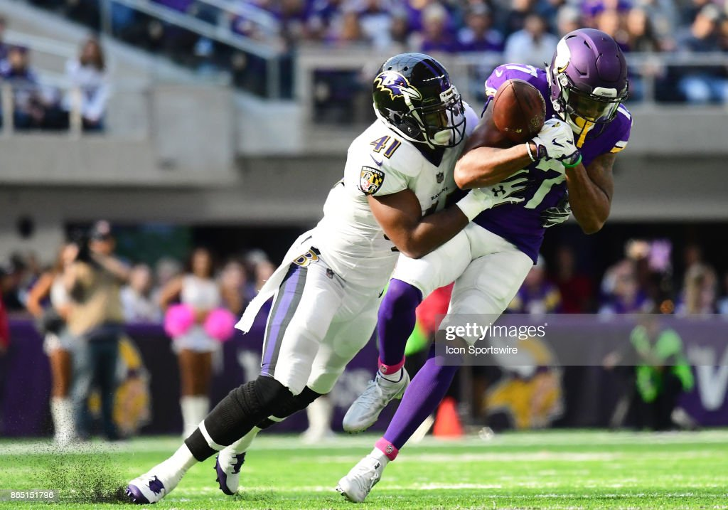 3ed4cc3cc Minnesota Vikings wide receiver Jarius Wright (17) catches a ball while  being hit by ...