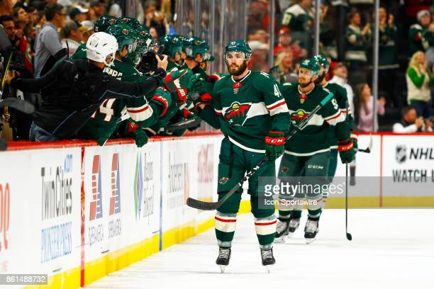 Minnesota Wild center Landon Ferraro is congratulated after scoring his first goal in the NHL in the 2nd period during the regular season game...