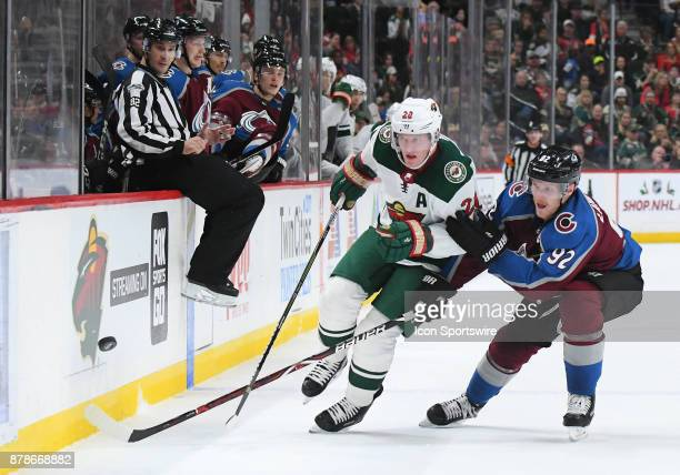 Minnesota Wild Defenceman Ryan Suter and Colorado Avalanche Left Wing Gabriel Landeskog battle for a loose puck during a NHL game between the...