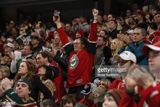 Minnesota Wild fans celebrate after a goal is scored against the Calgary Flames during the game at Xcel Energy Center on January 16 2008 in Saint...