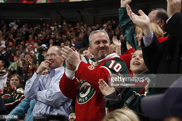 Minnesota Wild fans celebrate after their team scores a goal against the St Louis Blues during the game at Xcel Energy Center on November 30 2007 in...