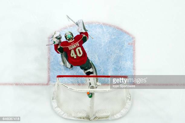 Minnesota Wild goalie Devan Dubnyk celebrates after right wing Mikael Granlund scored in overtime during the regular season game between the Los...