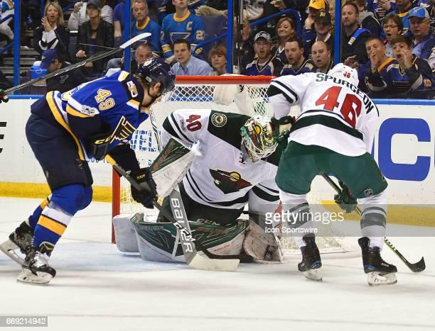 Minnesota Wild goalie Devan Dubnyk freezes the puc on a shot by St Louis Blues center Ivan Barbashev in the first period during game 3 of the first...