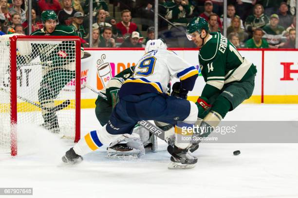 Minnesota Wild goalie Devan Dubnyk makes a save on St Louis Blues left wing Ivan Barbashev in overtime during Game 1 of the Western Conference...