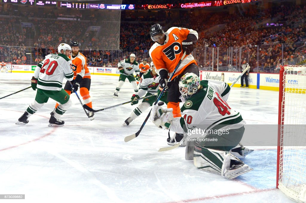 Minnesota Wild goalie Devan Dubnyk (40) makes the save against Philadelphia Flyers right wing Wayne Simmonds (17) during the NHL game between the Minnesota Wild and the Philadelphia Flyers on November 11, 2017 at the Wells Fargo Center in Philadelphia PA.