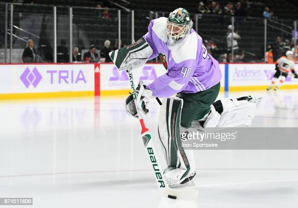 Minnesota Wild Goalie Devan Dubnyk wears a lavender jersey during warmups on Hockey Fights Cancer Awareness Night before a NHL game between the...