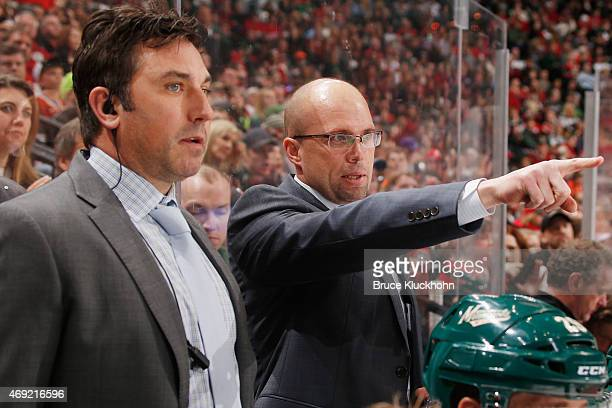 Minnesota Wild head coach Mike Yeo and assistant coach Andrew Brunette talk during the game against the Detroit Red Wings at the Xcel Energy Center...