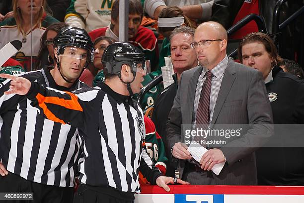 Minnesota Wild Head Coach Mike Yeo talks with referee Justin St Pierre during the game against the Nashville Predators on December 20 2014 at the...