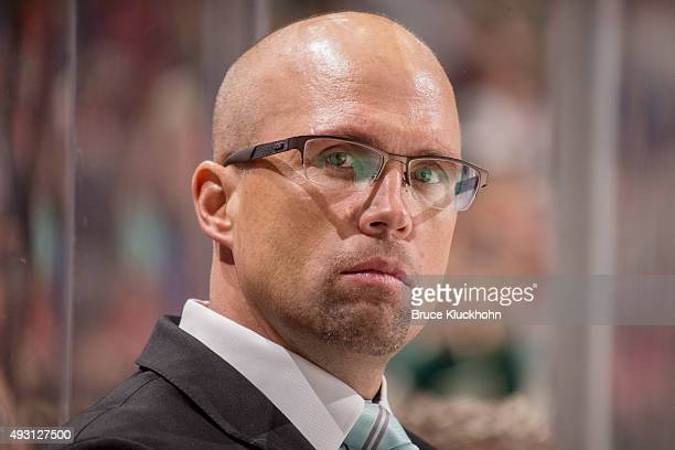 Minnesota Wild Head Coach Mike Yeo watches from the bench against the St Louis Blues during the game on October 10 2015 at the Xcel Energy Center in...