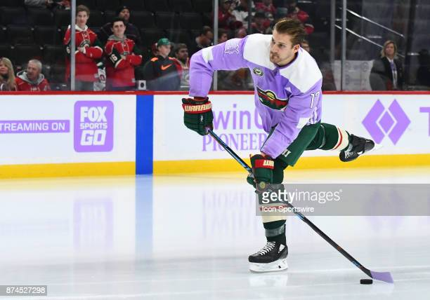 Minnesota Wild Left Wing Marcus Foligno wears a lavender jersey during warmups on Hockey Fights Cancer Awareness Night before a NHL game between the...