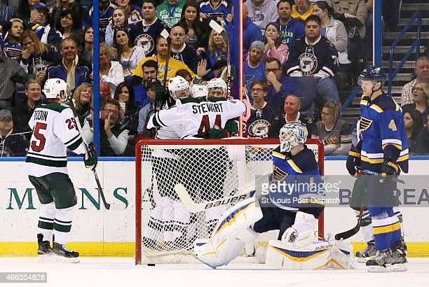 Minnesota Wild players celebrate behind St Louis Blues goaltender Brian Elliott after right wing Nino Niederreiter after scoring the goahead goal in...