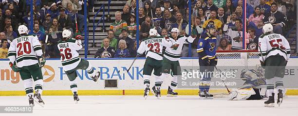 Minnesota Wild players celebrate Kyle Brodziak's unassisted goal past St Louis Blues goaltender Brian Elliott in thirdperiod action on Saturday March...