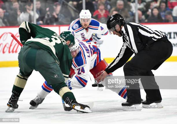 Minnesota Wild Right Wing Charlie Coyle and New York Rangers Center Oscar Lindberg faceoff during an NHL game between the Minnesota Wild and New York...