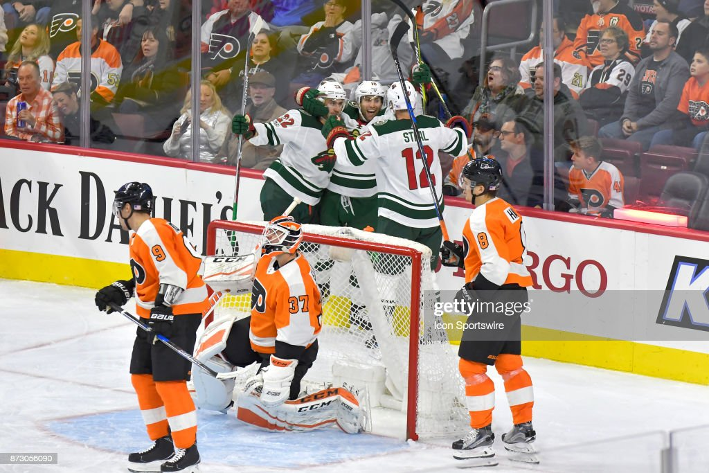 Minnesota Wild right wing Chris Stewart (10) Minnesota Wild right wing Nino Niederreiter (22) and Minnesota Wild center Eric Staal (12) celebrate the winning and only goal giving victory to the Minnesota Wild during the NHL game between the Minnesota Wild and the Philadelphia Flyers on November 11, 2017 at the Wells Fargo Center in Philadelphia PA.