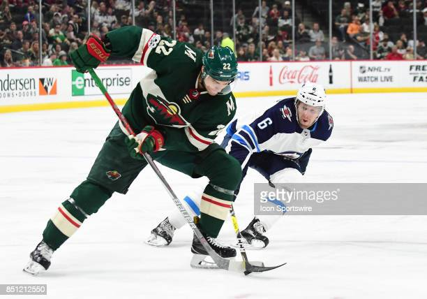 Minnesota Wild right wing Nino Niederreiter protects the puck from Winnipeg Jets center Cameron Schilling during a preseason NHL game between the...
