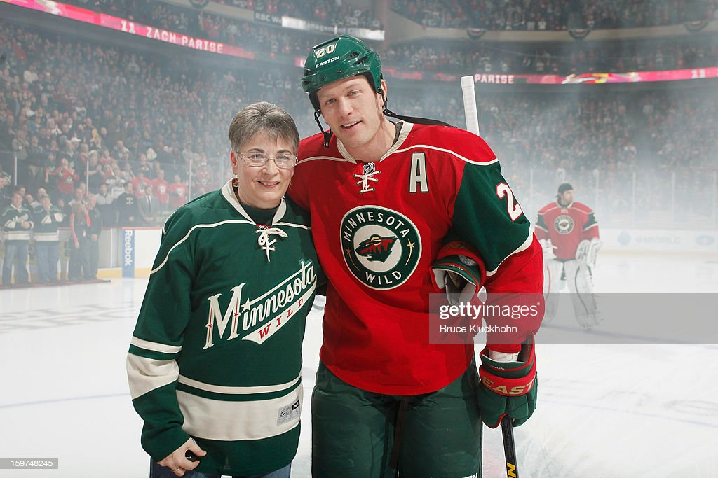 A Minnesota Wild season ticket holder poses for a picture with Ryan Suter #20 of the Minnesota Wild during a pre-game ceremony prior to the game against the Colorado Avalanche on January 19, 2013 at the Xcel Energy Center in Saint Paul, Minnesota.