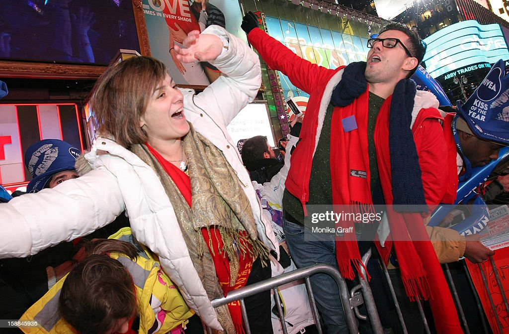 Minnie and Andrew Papas from England celebrate as the stroke of midnight rings in the new year in Times Square on January 1, 2013 in New York City. Approximately one million people are expected to ring in the new year in Times Square.