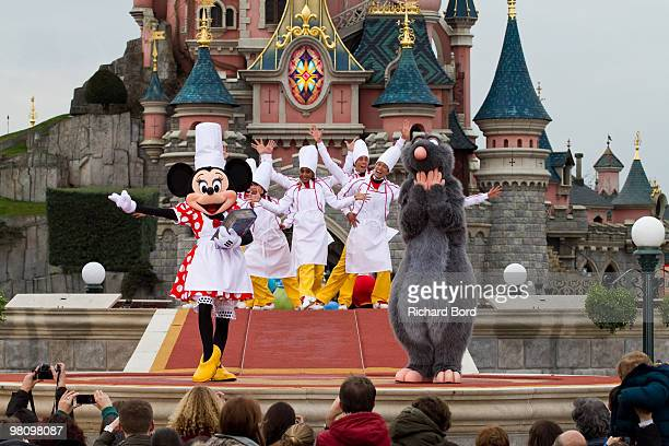 Minnie Dancers and Remy perform during a show in the front of the Cinderella Castle during the New Generation Year Launch at Disneyland Paris on...