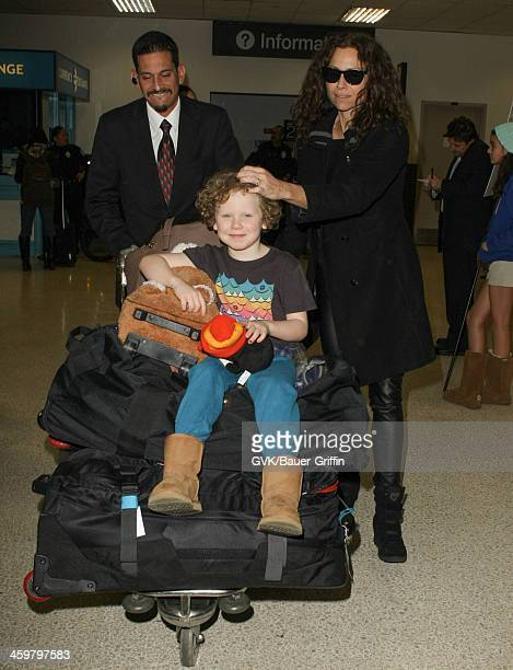 Minnie Driver and her son Henry Story Driver are seen at Los Angeles International airport on December 30 2013 in Los Angeles California