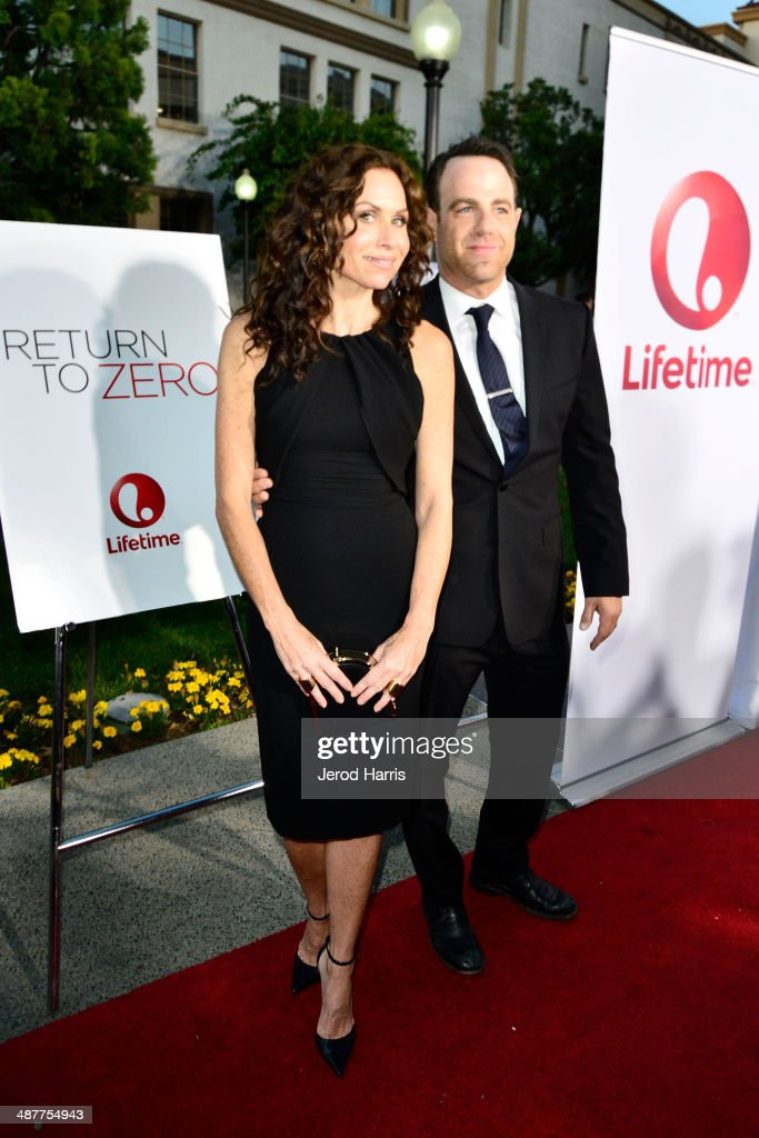 <a gi-track='captionPersonalityLinkClicked' href=/galleries/search?phrase=Minnie+Driver&family=editorial&specificpeople=201884 ng-click='$event.stopPropagation()'>Minnie Driver</a> and <a gi-track='captionPersonalityLinkClicked' href=/galleries/search?phrase=Paul+Adelstein&family=editorial&specificpeople=665401 ng-click='$event.stopPropagation()'>Paul Adelstein</a> arrive at the Premiere of Lifetime Television's 'Return To Zero' at Paramount Theater on the Paramount Studios lot on May 1, 2014 in Hollywood, California.