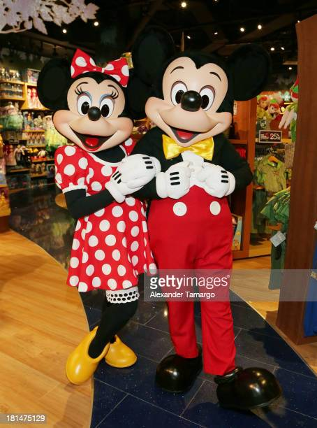 Minnie Mouse and Mickey Mouse are seen at the Disney Store grand opening at Miami International Mall on September 21 2013 in Miami Florida