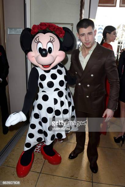 Minnie Mouse and Nick Jonas attend Fashion LA Awards at the Sunset Tower Hotel on April 2 2017 in West Hollywood California Minnie is wearing a...