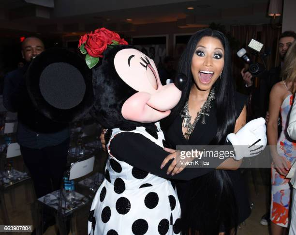 Minnie Mouse and Nicki Minaj attend Fashion LA Awards at the Sunset Tower Hotel on April 2 2017 in West Hollywood California Minnie is wearing a...
