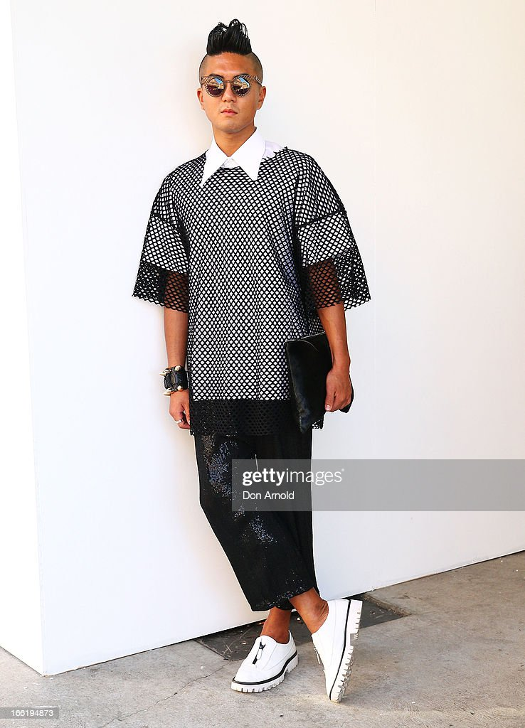 Mino Kim wears a shirt by Ralph Simmon, mesh top by Zambesi and pants by Zambesi at Mercedes-Benz Fashion Week Australia Spring/Summer 2013/14 at Carriageworks on April 10, 2013 in Sydney, Australia.