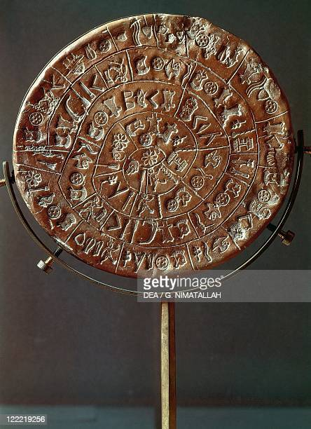 Minoan civilization 17th century bC Phaistos disc Clay disc engraved with ideographic symbols Side A