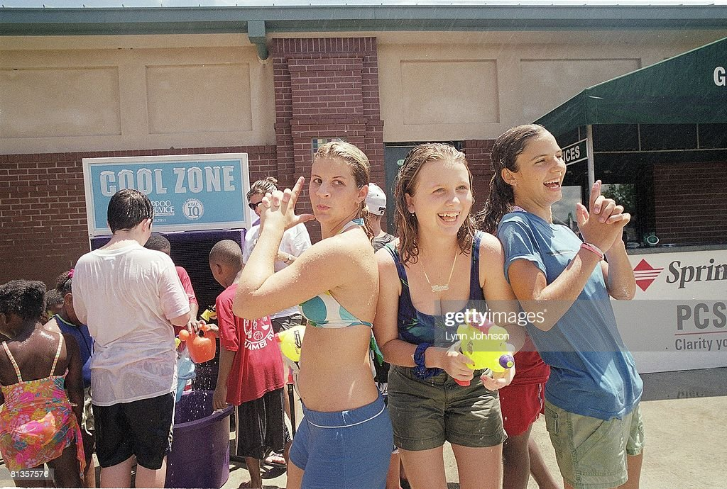 Portrait of Rebecca Veeck (C) with water gun, daughter of Charleston RiverDogs owner Mike Veeck, Charleston, SC 7/23/2005