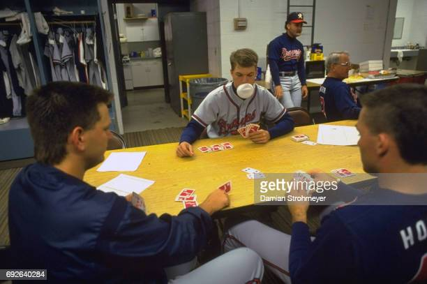 Richmond Braves Chipper Jones blowing bubble gum and playing cards with teammates in locker room before game vs Syracuse Chiefs at MacArthur Stadium...