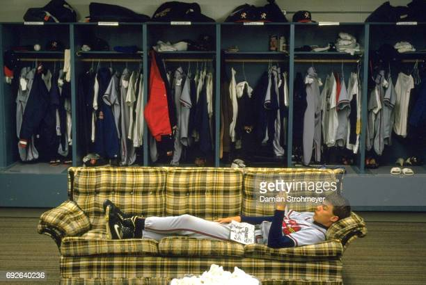 Richmond Braves Chipper Jones laying on couch in locker room before game vs Syracuse Chiefs at MacArthur Stadium Syracuse NY CREDIT Damian Strohmeyer
