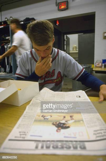 Richmond Braves Chipper Jones reading newspaper in locker room before game vs Syracuse Chiefs at MacArthur Stadium Syracuse NY CREDIT Damian...