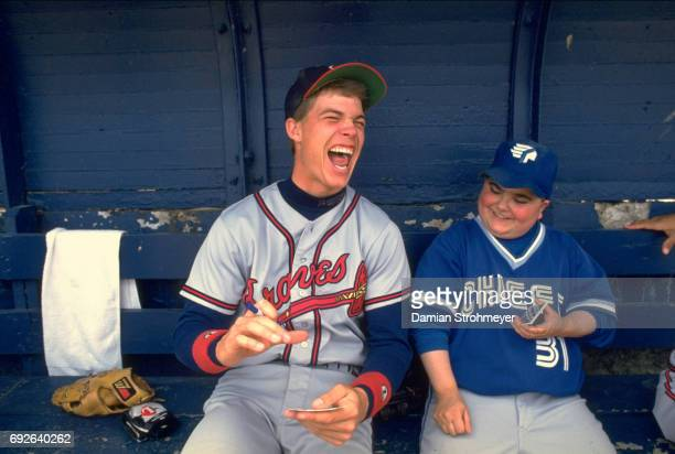 Richmond Braves Chipper Jones signing autographs in dugout with Syracuse Chiefs batboy Sparky in dugout before game at MacArthur Stadium Syracuse NY...