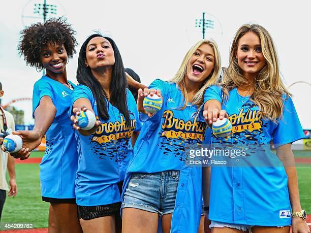 Sports Illustrated swimsuit models Adaora Akubilo Ariel Meredith Gigi Hadid and Hannah Davis posing on field before Brooklyn Cyclones vs TriCity...