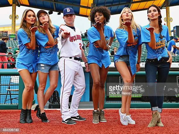 Sports Illustrated swimsuit models Hannah Davis Jess Perez Adaora Akubilo Gigi Hadid and Lily Aldridge on field with Brooklyn Cyclones second baseman...