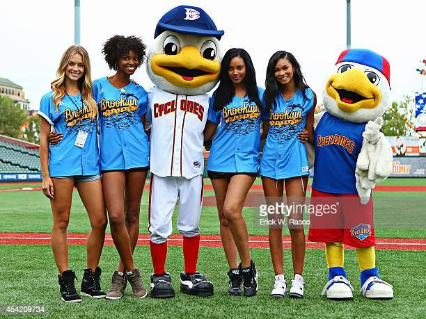 Sports Illustrated swimsuit models Hannah Ferguson Adaora Akubilo Ariel Meredith and Chanel Iman on field with mascots Sandy the Seagull and PeeWee...