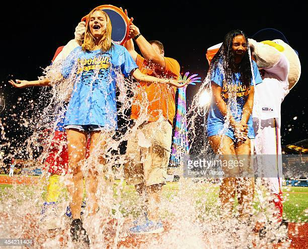 Sports Illustrated swimsuit models Jess Perez and Ariel Meredith having water coolers dumped over them for ALS Ice Bucket Challenge before Brooklyn...