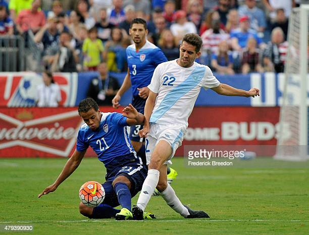 Minor Lopez of Guatemala collides with Timmy Chandler of the United States during the first half of an international friendly match at Nissan Stadium...