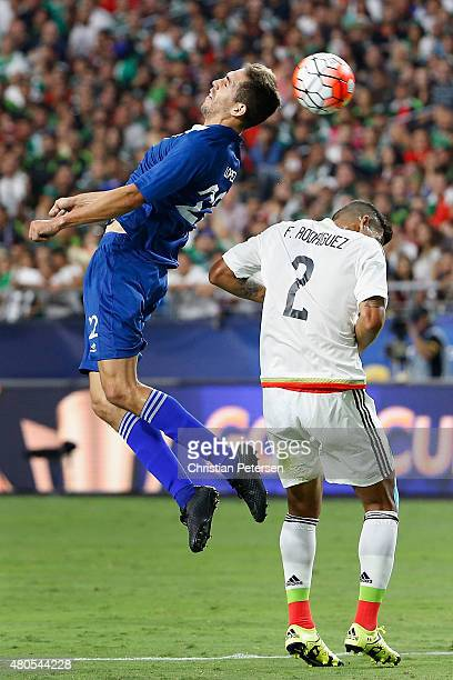 Minor Lopez of Guatemala heads the ball over Fransisco Javier Rodriguez of Mexico during the first half of the 2015 CONCACAF Gold Cup group C match...