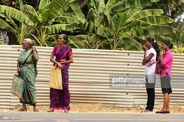 Minority ethnic Tamil eldest women and young girls wait for public bus in the remote village of Chunnakam on August 122015 in Jaffna Sri Lanka The...