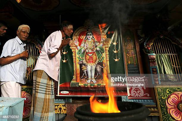 Minority ethnic Tamil men pray in the Hindu temple on August 122015 in Jaffna Sri Lanka The UN's Human Rights Council investigation into alleged war...
