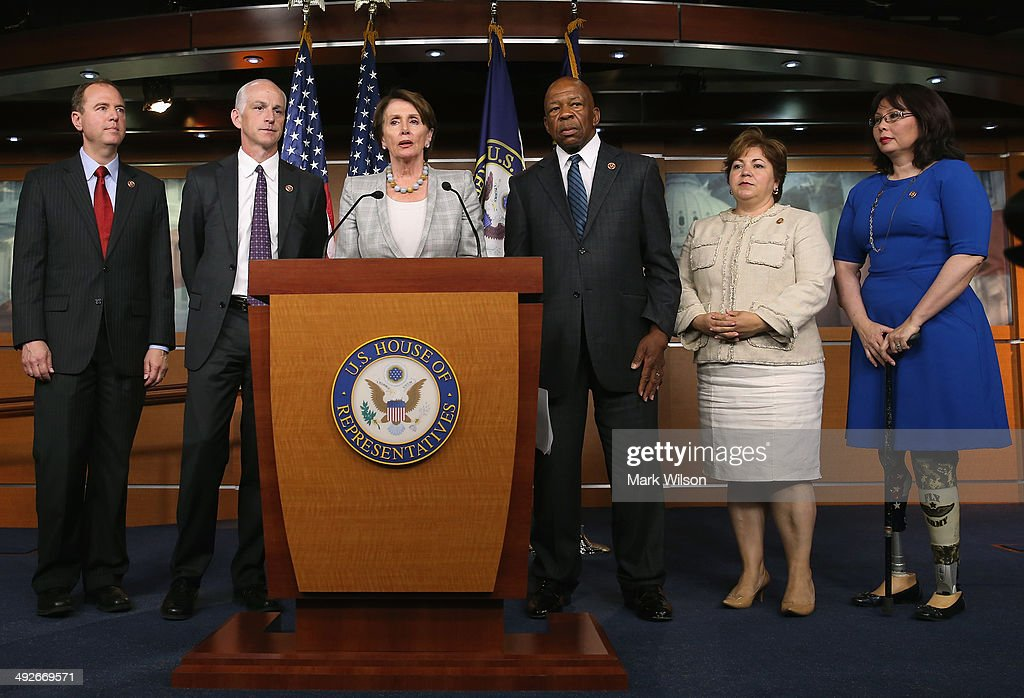 Minority Leader <a gi-track='captionPersonalityLinkClicked' href=/galleries/search?phrase=Nancy+Pelosi&family=editorial&specificpeople=169883 ng-click='$event.stopPropagation()'>Nancy Pelosi</a> (D-CA) (C) speaks while flanked by five fellow Democrats (L-R) Rep. Rep. Adam B. Schiff (D-CA), Rep. Adam Smith (D-WA), Rep. Elijah E. Cummings (D-MD), Rep. Linda Sanchez, (D-CA) and Rep. Tammy Duckworth (D-IL) during a news conference on Capitol Hill, May 21, 2014 in Washington, DC. Leader Pelosi named the five Democrats to serve on the special committee looking into the 2012 attack in Benghazi, Libya.