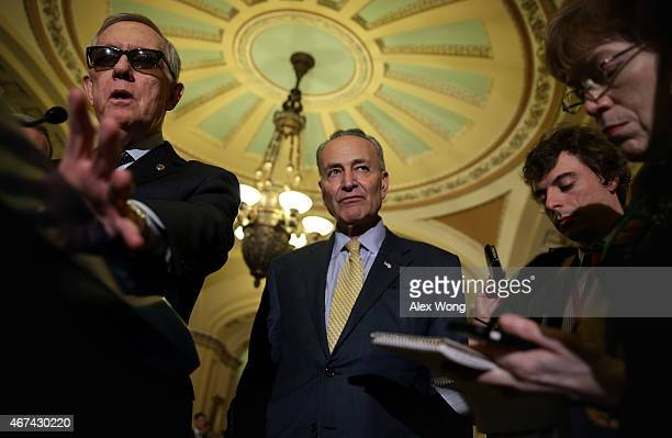 S Minority Leader Sen Harry Reid speaks to members of the media as Sen Charles Schumer listens after the weekly Democratic Policy Luncheon March 24...