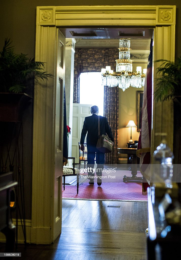 Minority Leader Senator Mitch McConnell (R-KY) enters his office before the Senate comes back into a rare Sunday session to consider a possible deal crafted on Saturday behind the scenes to prevent a dive off the 'fiscal cliff', on Capitol Hill, Sunday, December 30, 2012.
